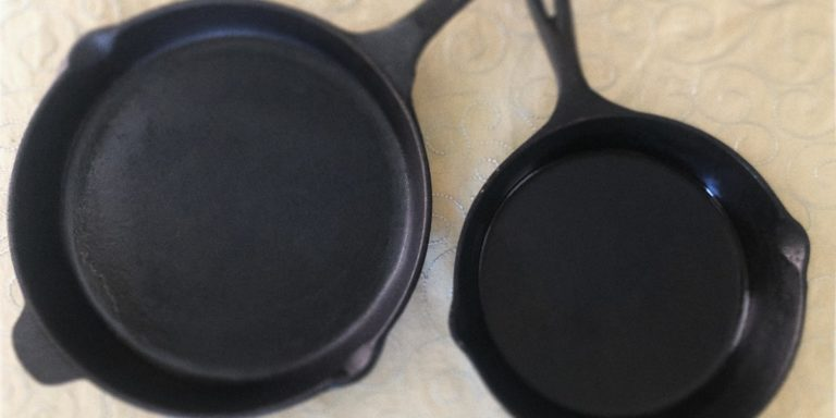 Two cast irons pans on a table